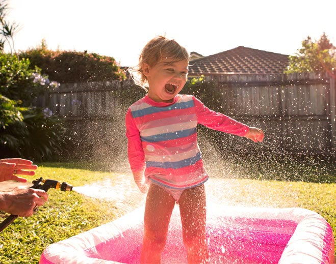 Girl Playing in water